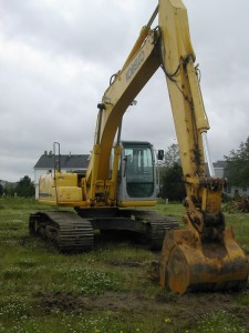 Excavator Digs & Backfills Homes