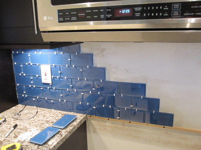 Glass subway tile backsplash bill house plans for Advantages of using glass tile backsplash
