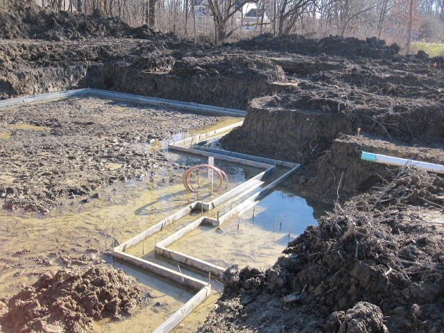 House Foundation Excavation Dealing With High Water