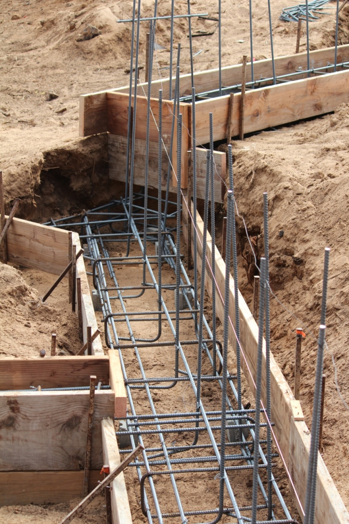 Footings are the next step in our how to build a home blog for Basement foundations construction