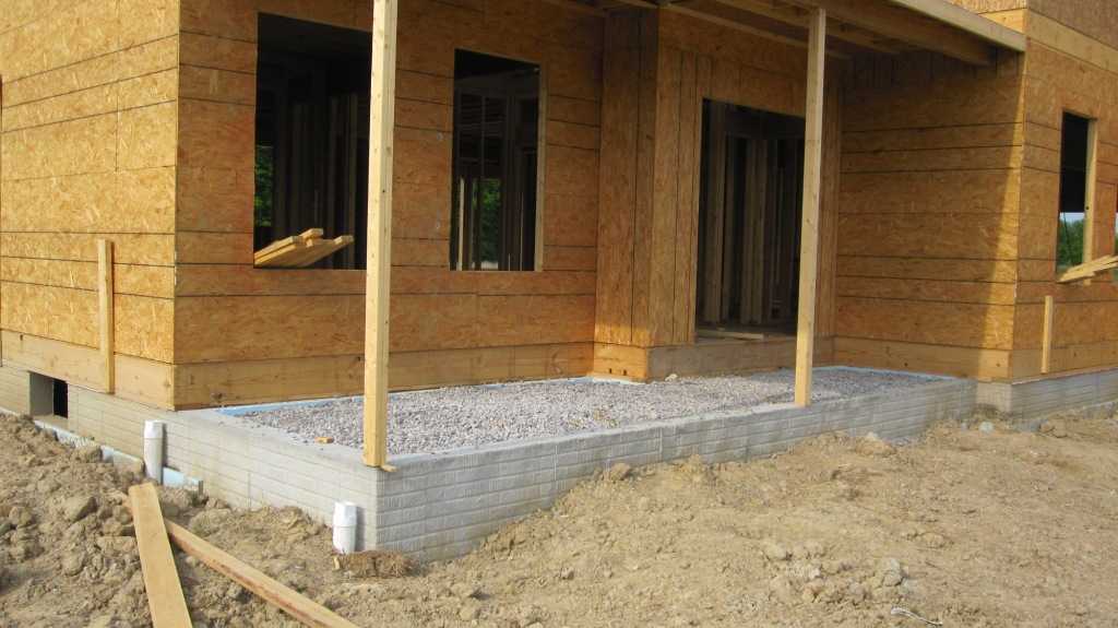 Install masonry and siding step 41 in our how to build a for Steps to building your own house