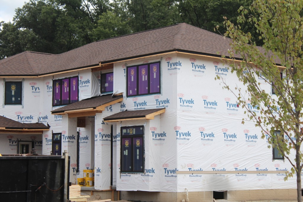 Housewrap for building a tight home proper install and for Save money building a house